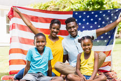 Happy family showing usa flag Stock Images