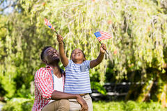 Happy family showing usa flag Stock Photo
