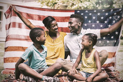 Happy family showing with USA flag Royalty Free Stock Photos