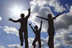 Happy family silhouette on sunny sky Stock Image