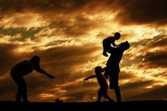Happy family with silhouettes. Stock Photos