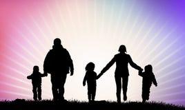 Happy family silhouettes Stock Photos