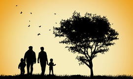 Happy family silhouettes Stock Photos