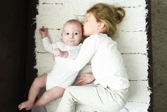Sister girl hugs newborn brother stock image