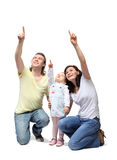 Happy family sit down and point fingers up stock photo