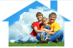 Happy family sit on green grass under sky. Happy family sit in house on green grass under sky with clouds Stock Photos