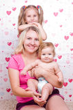 Happy family sits on the carpet Royalty Free Stock Photography