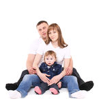 Happy family sits together. Royalty Free Stock Image