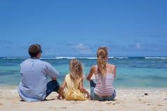 Happy family sitting on the beach Royalty Free Stock Photos