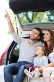 Happy family sitting in car Stock Photos