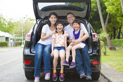 Happy family sitting in the car stock photo