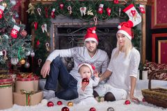 Happy family sitting in festive Christmas room royalty free stock image