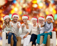 Happy family sitting on couch Royalty Free Stock Image