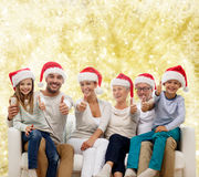Happy family sitting on couch Royalty Free Stock Photography