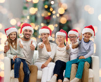 Happy family sitting on couch Stock Photography