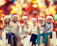 Happy family sitting on couch Stock Images