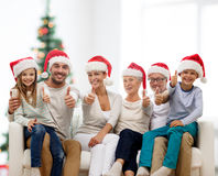 Happy family sitting on couch at home Stock Photo