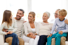Happy family sitting on couch at home Royalty Free Stock Image