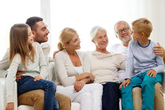 Happy family sitting on couch at home Royalty Free Stock Photography