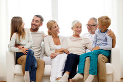 Happy family sitting on couch at home Stock Photography
