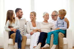 Happy family sitting on couch at home Stock Images