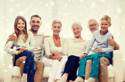 Happy family sitting on couch at home Royalty Free Stock Photos