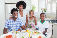 Happy family sitting down to dinner together Royalty Free Stock Photo