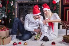 Happy family sitting in festive Christmas room Stock Photo