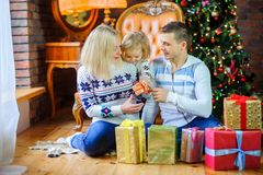 Happy family gives each other presents Royalty Free Stock Photography