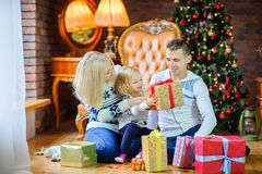 Happy family gives each other presents Royalty Free Stock Images