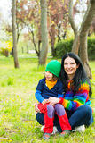 Happy family sitting in grass Stock Photography