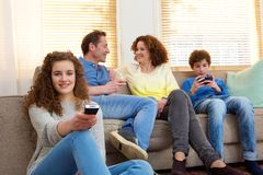 Happy family sitting at home relaxing in living room stock photography