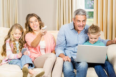 Happy family sitting at home Royalty Free Stock Photography