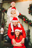 Happy Family Sitting Near Christmas Tree.  in red Stock Photos