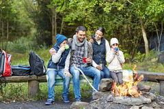 Free Happy Family Sitting On Bench At Camp Fire Royalty Free Stock Image - 61216796