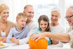 Happy family sitting with pumpkins at home Royalty Free Stock Image