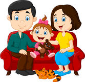 Happy family sitting on the red sofa Stock Photography