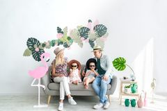 Happy family sitting on the sofa at home. Family portrait of four stock images