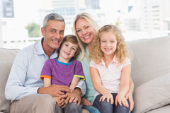 Happy family sitting on sofa at home Royalty Free Stock Photography
