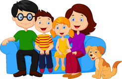 Happy family sitting on sofa Stock Image