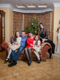 Happy family sitting on sofa at living room at christmas eve Royalty Free Stock Photography