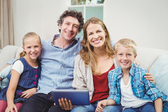 Happy family sitting on sofa in living room Royalty Free Stock Photography