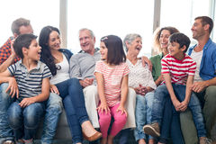 Happy family sitting on sofa stock photos