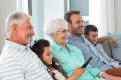 Happy family sitting on sofa stock image
