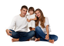 Happy family sitting in the studio Royalty Free Stock Photos