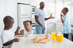 Happy family sitting and taking breakfast Royalty Free Stock Photos