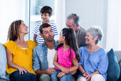 Happy family sitting together on sofa at home Royalty Free Stock Image