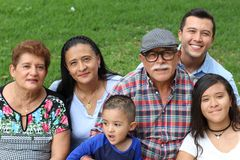 Happy family of six Latinos royalty free stock images