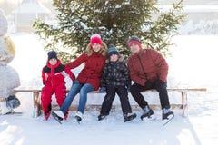 Happy family skate in the winter stock image