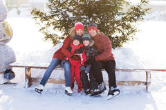 Happy family skate in the winter Royalty Free Stock Images